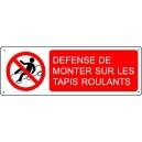 Défense de monter sur les tapis roulants